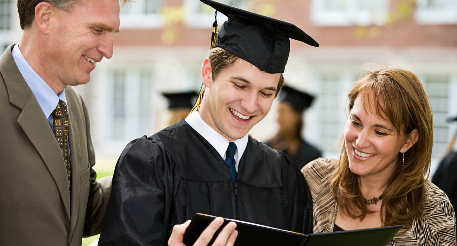 student and parents at graduation