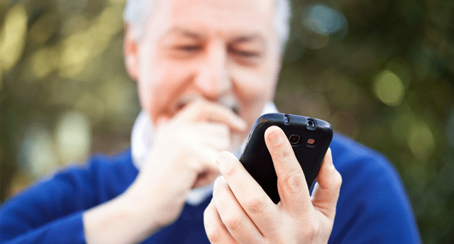 old man holding mobile phone