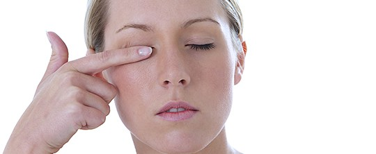 woman rubbing dry eye