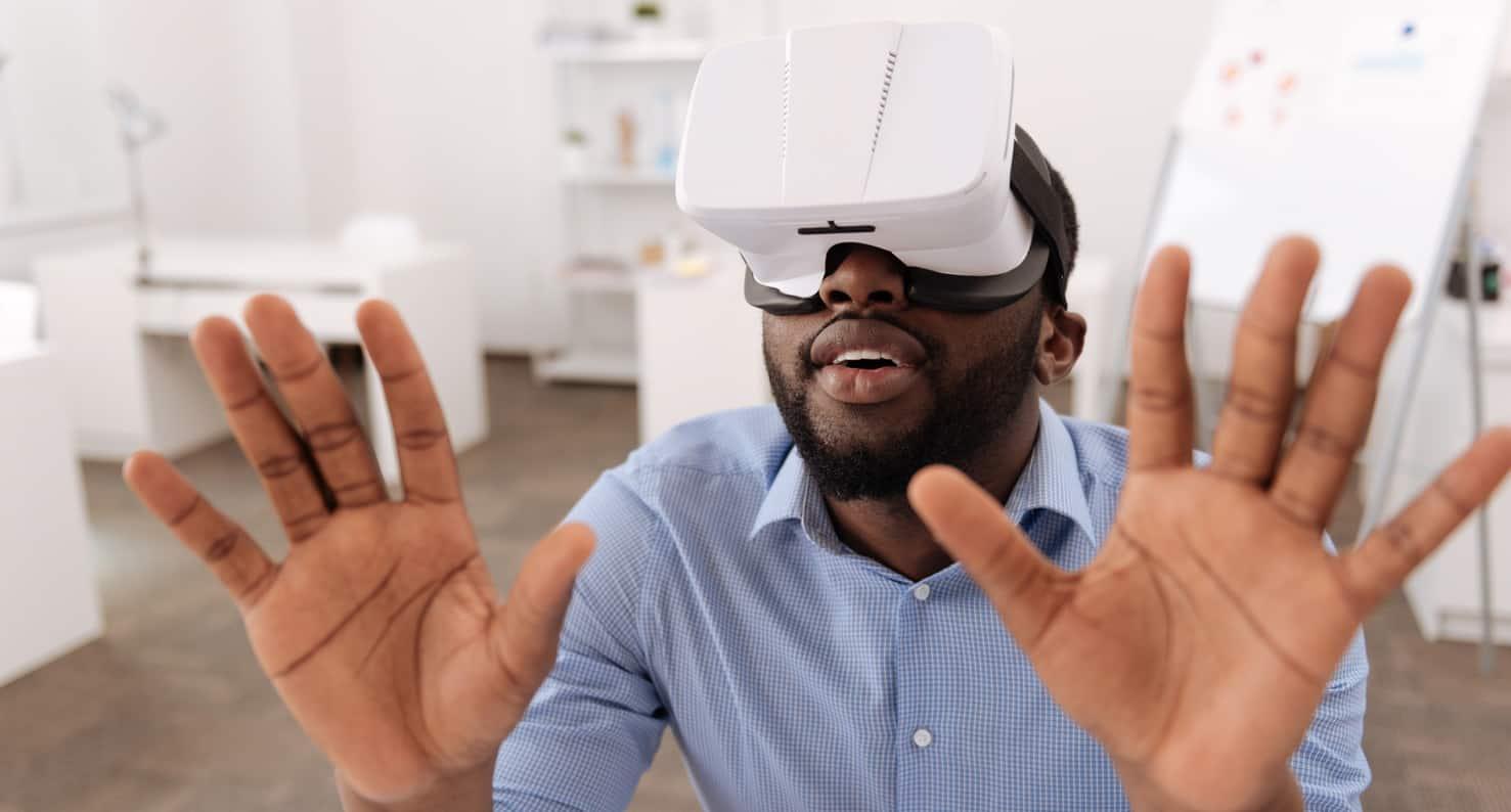 Man using virtual reality head set