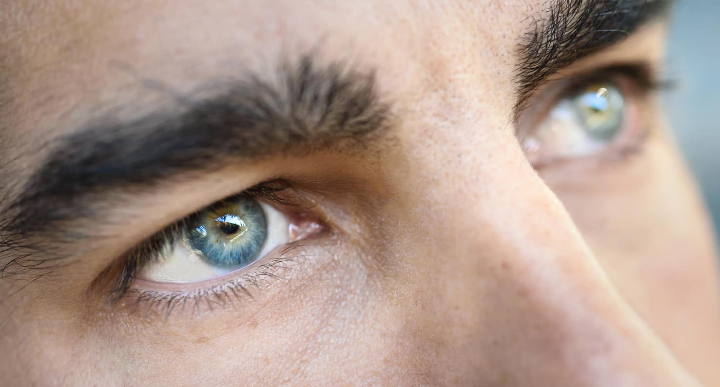 close up on blue eyed man thinking about icl