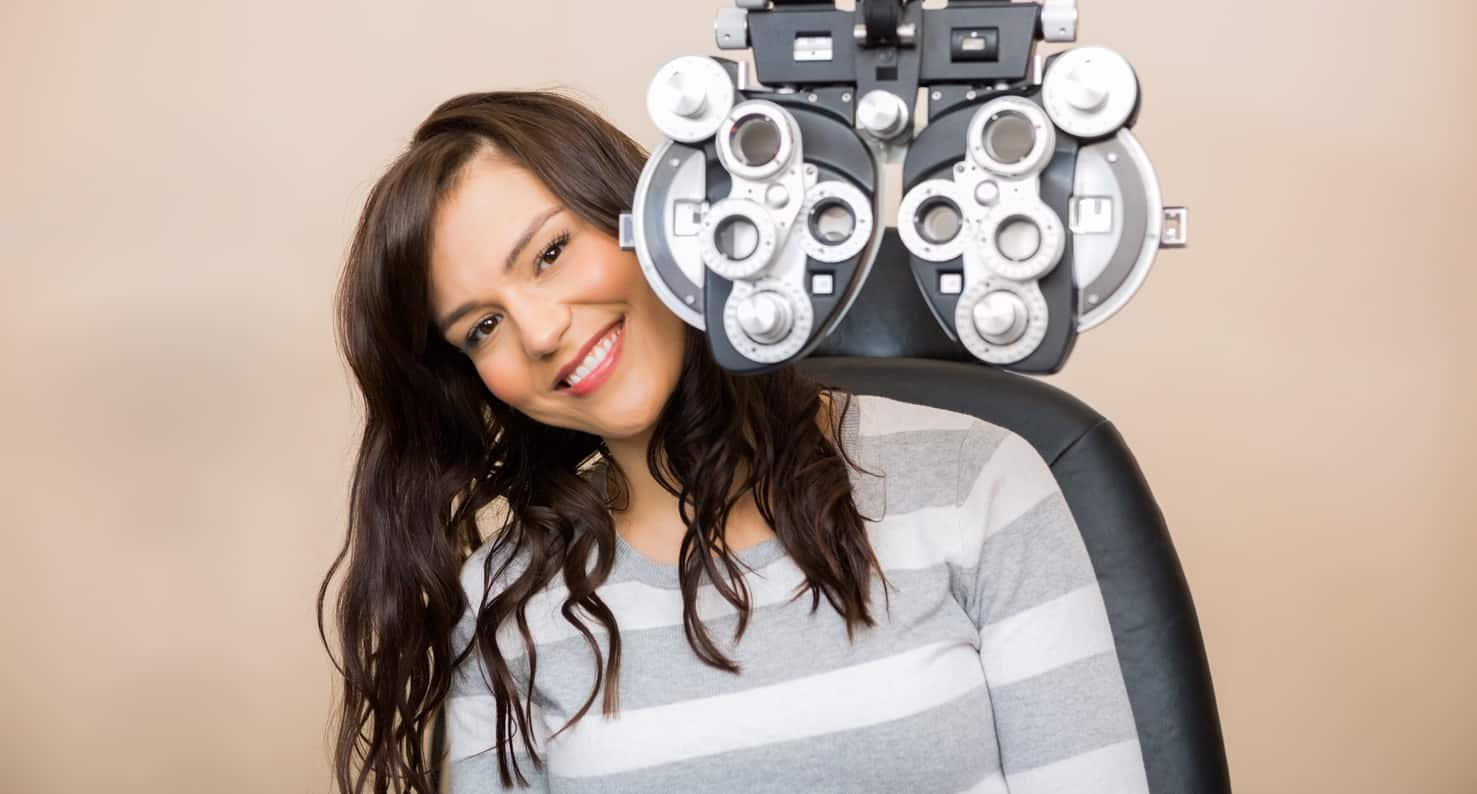 young woman getting eye exam