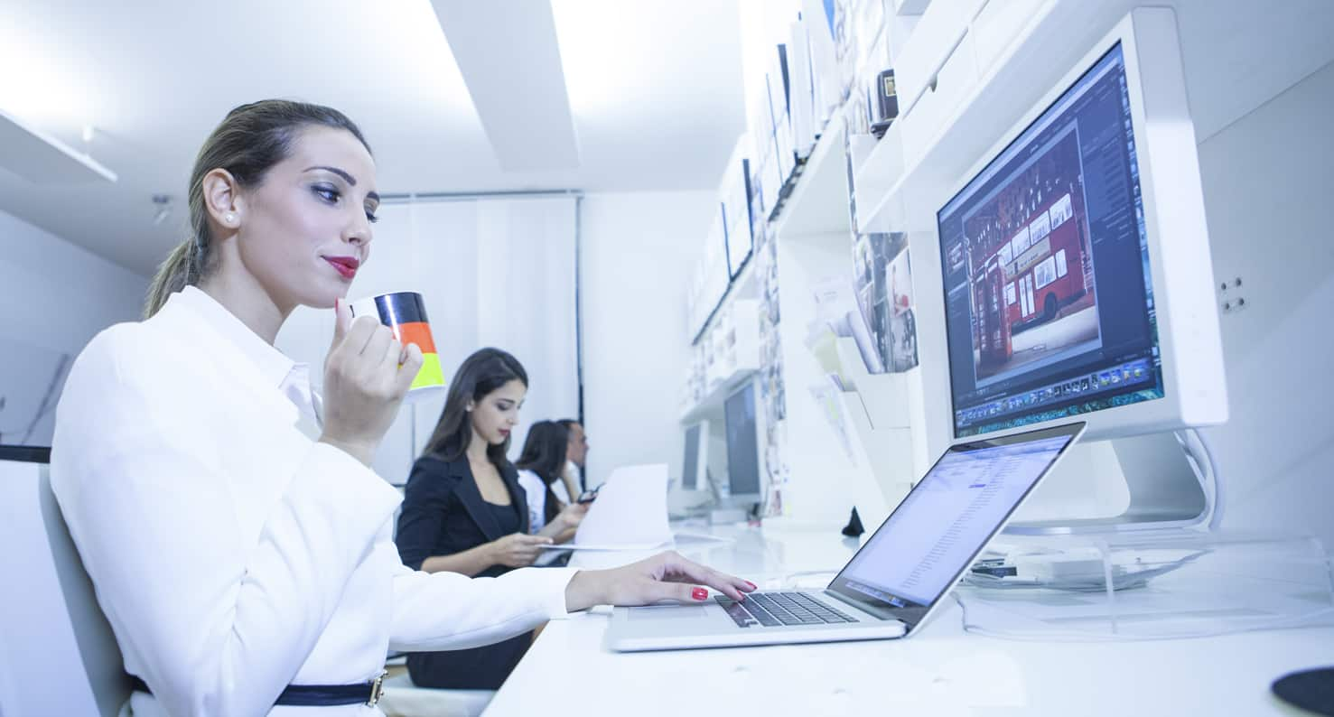 woman at a computer following the eye strain rules
