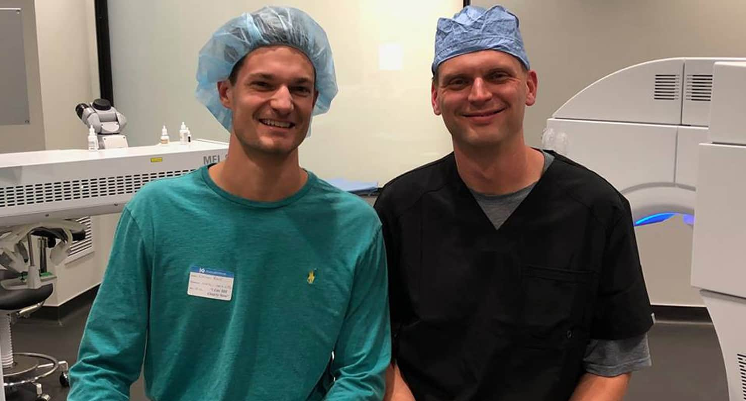 Dr. Kugler and a happy patient smiling- day of LASIK photo.