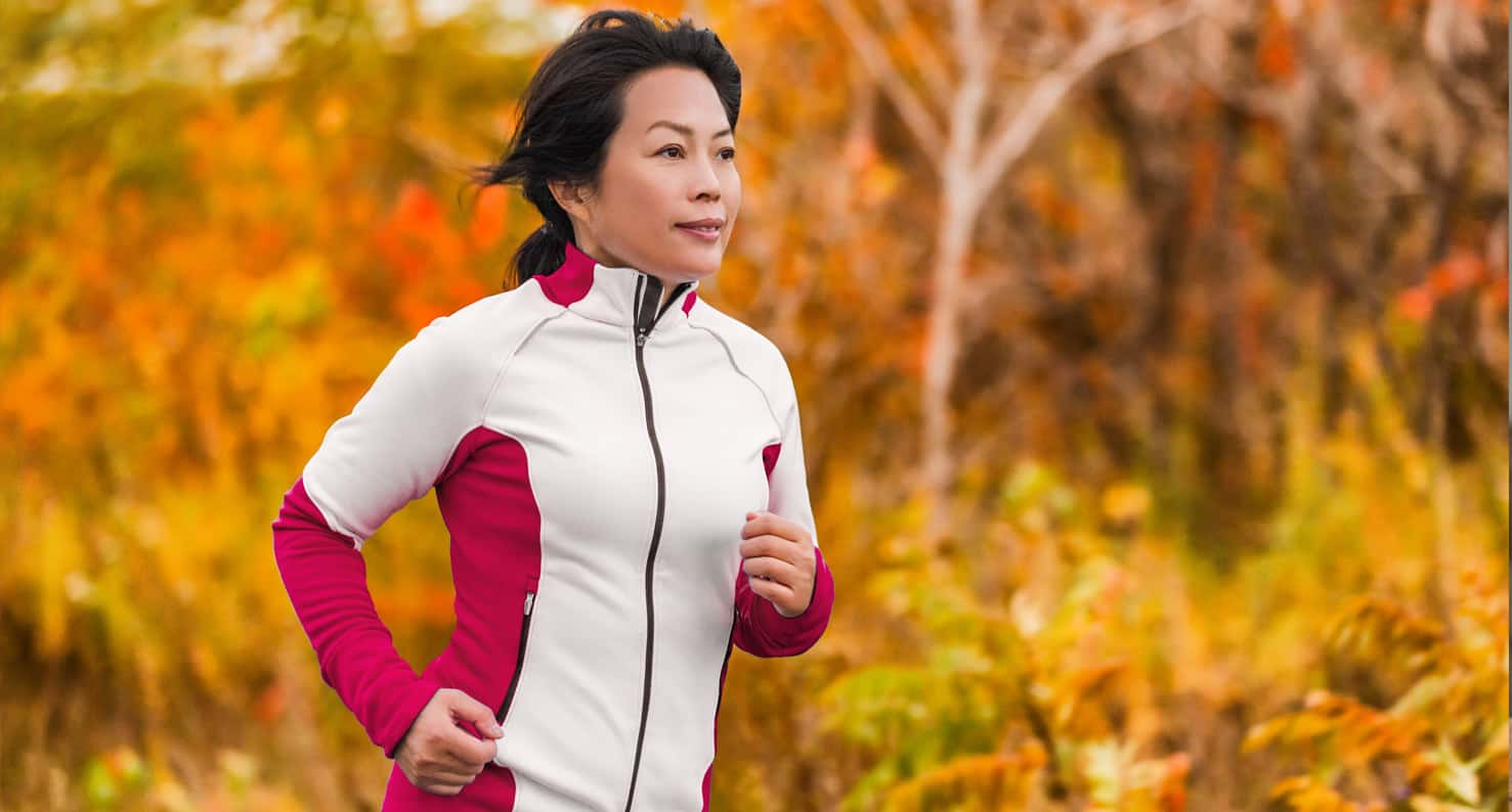 A woman is running outside during Autumn.