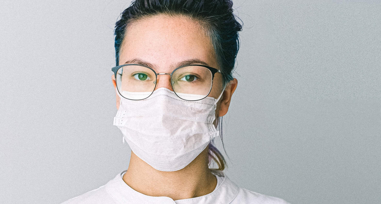 A woman is dealing with masks and foggy glasses