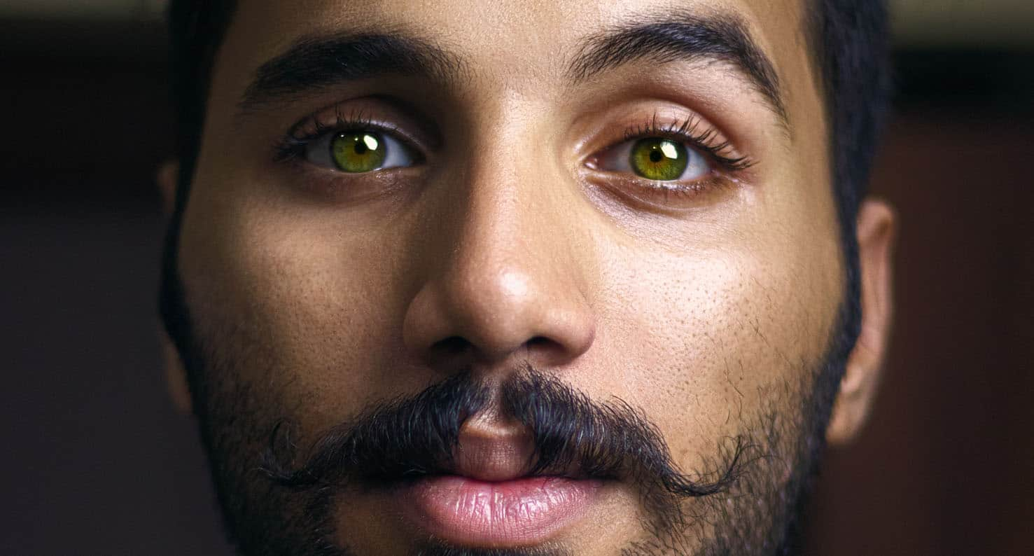 close up of man with green eyes