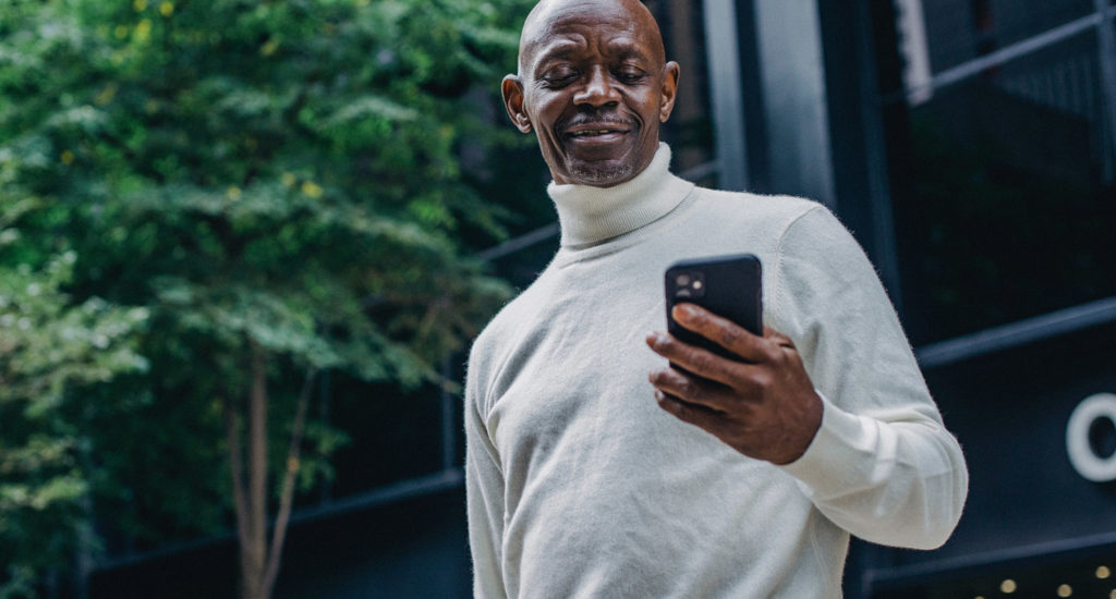 a man researches on his phone what is presbyopia