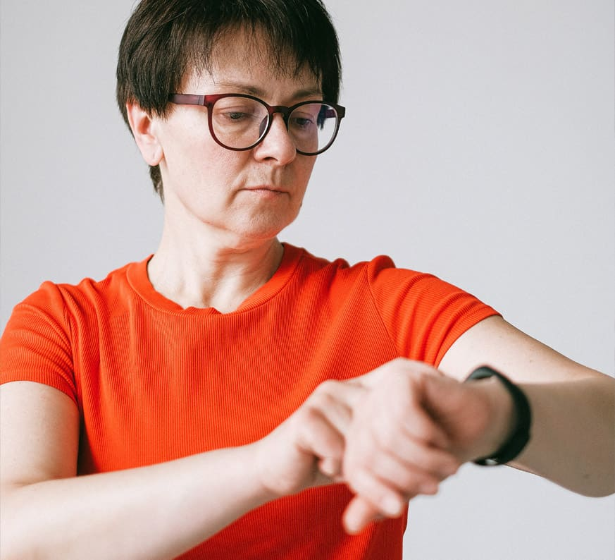 a woman with presbyopia needs readers to see her watch
